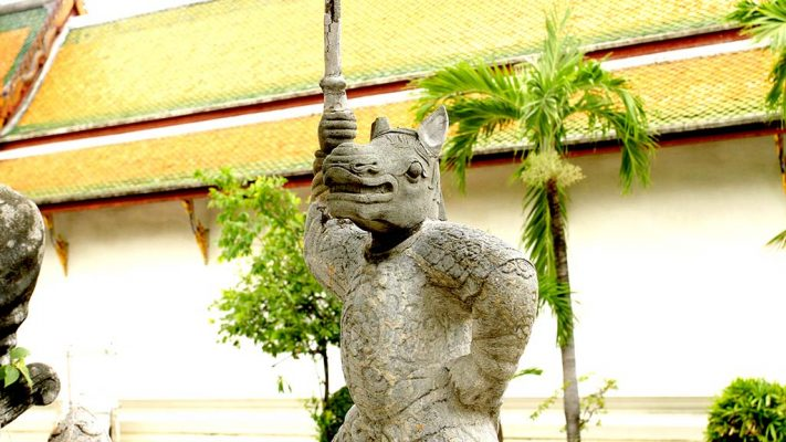 Statue in the courtyard of Wat Suthat Thepwararam.